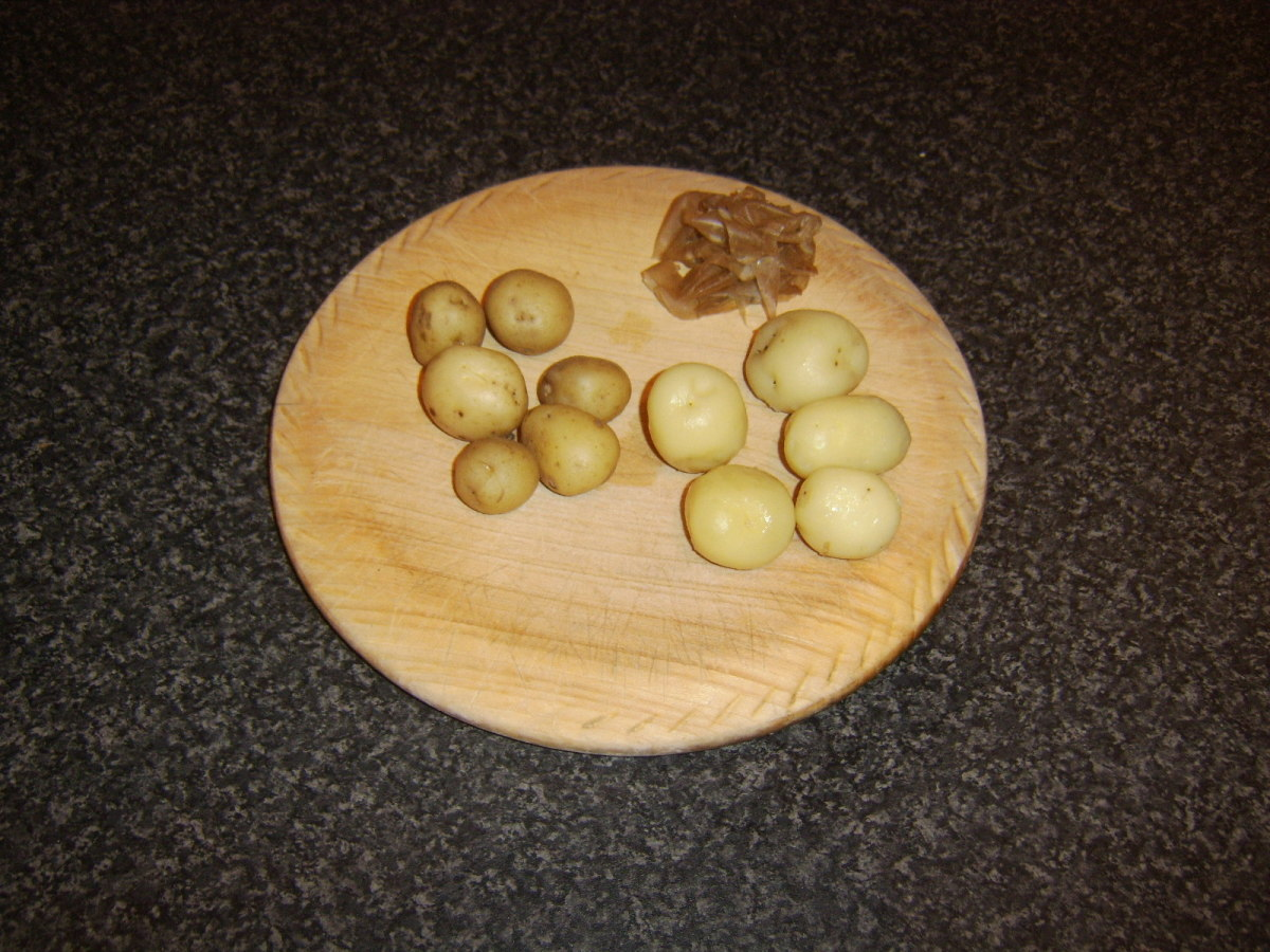 Peeling cooked potatoes for roasting