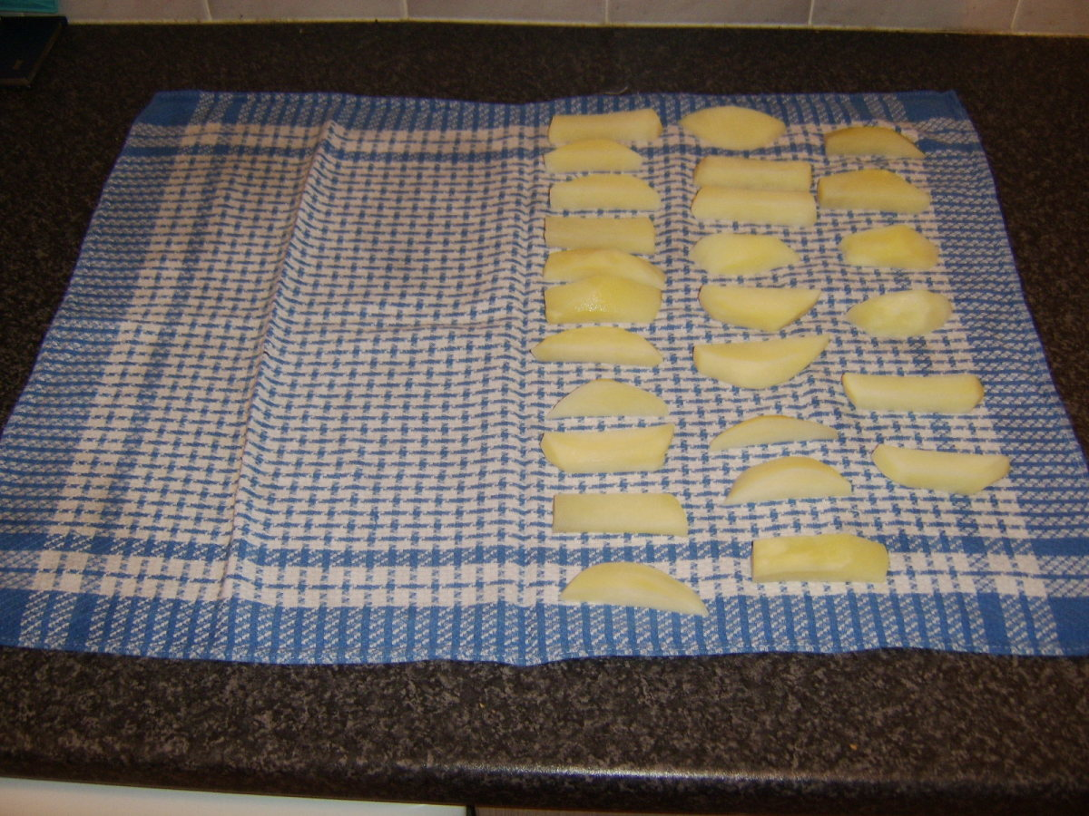 Drying parboiled potatoes for deep frying