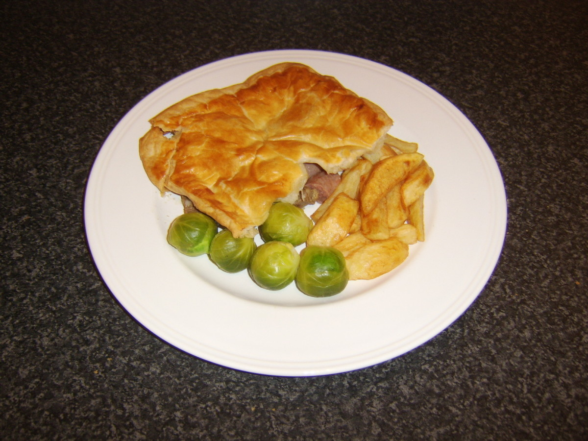 Diced beef and beef link sausages, topped with puff pastry, comprises a traditional Scottish steak pie