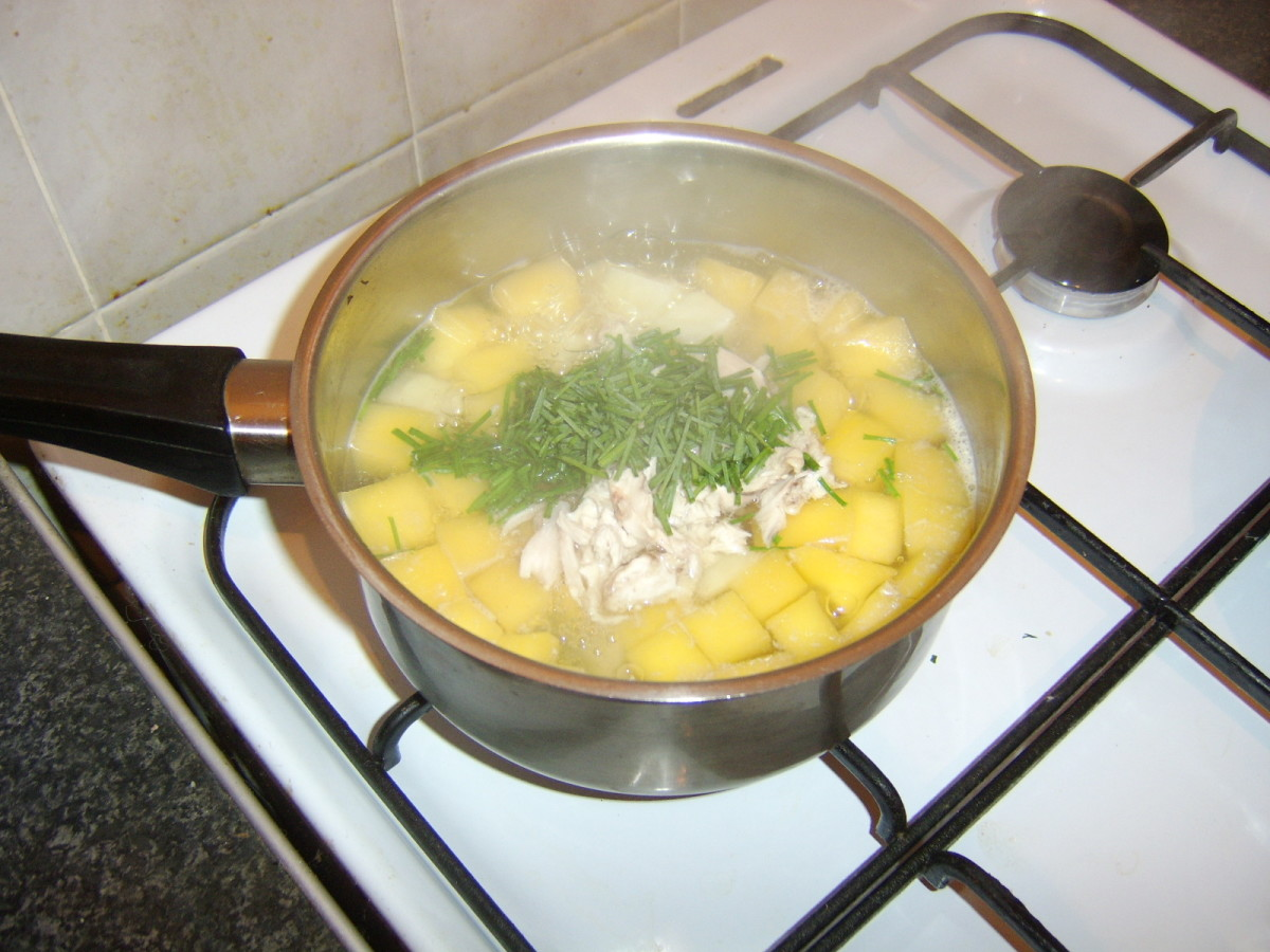 Chicken and chives are added last to the broth
