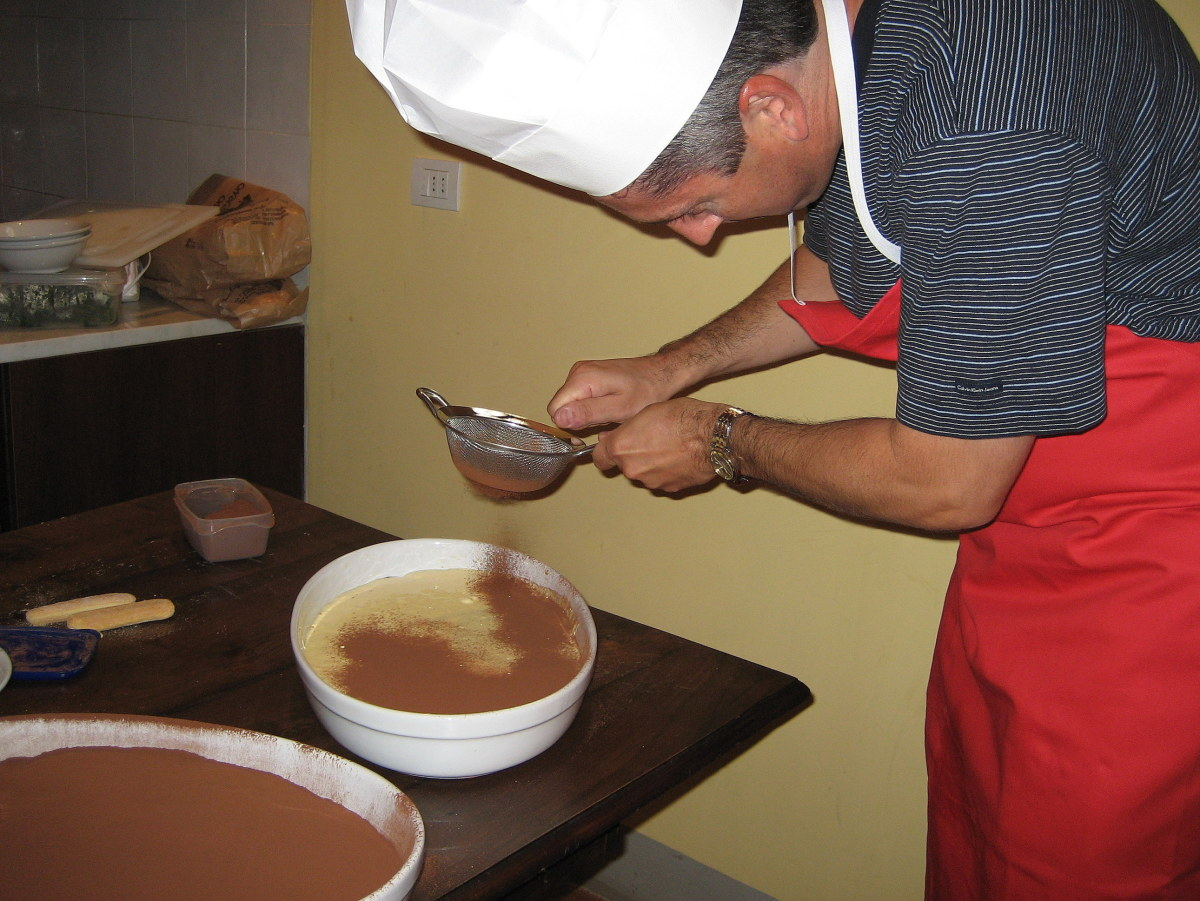 A student adds the cocoa powder to the finished dessert