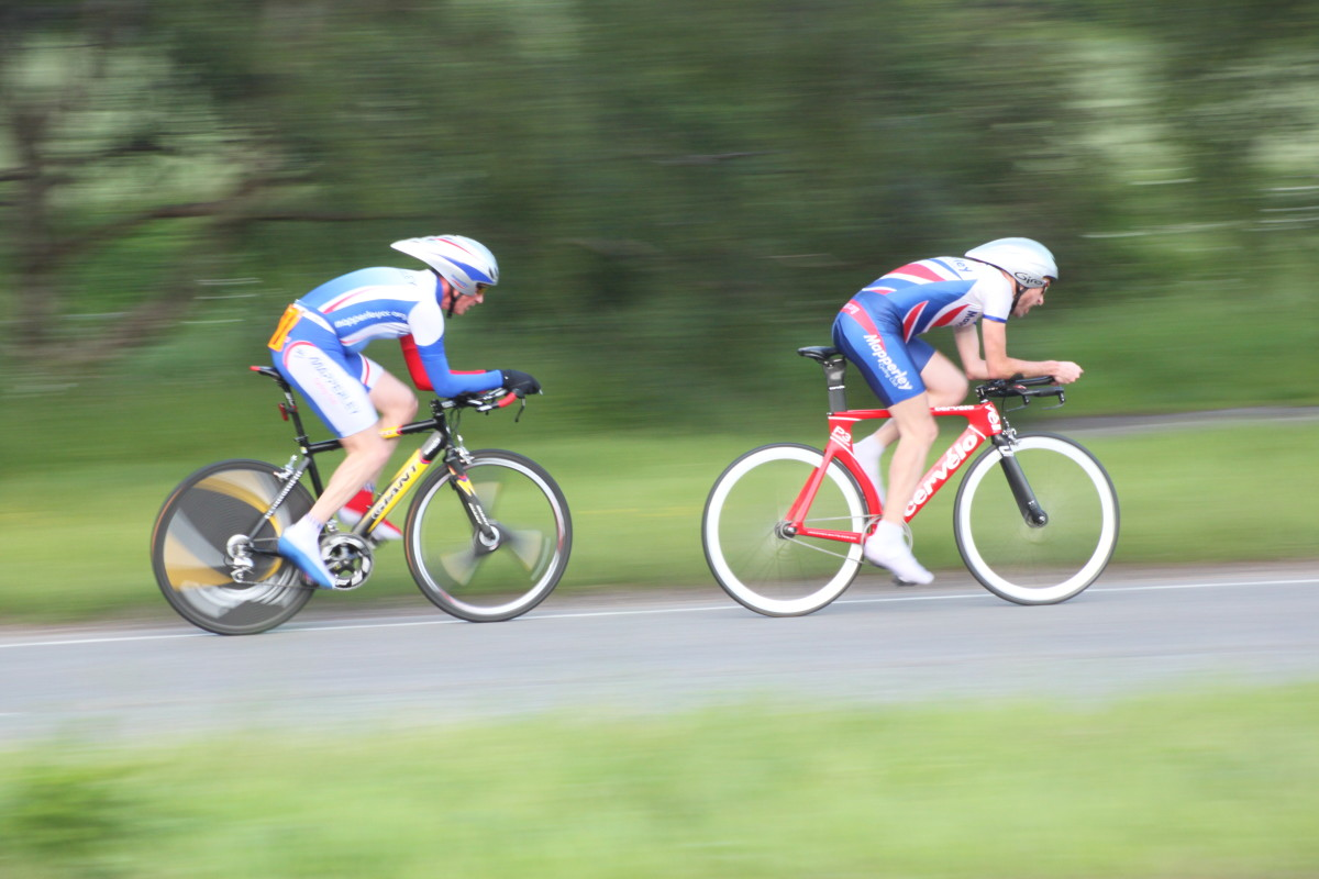 Time Trial cyclists looking aerodynamic in their Giro Advantage aero helmets. Features bikes are a Cervelo P3 Track frameset and Giant TCR Aero.