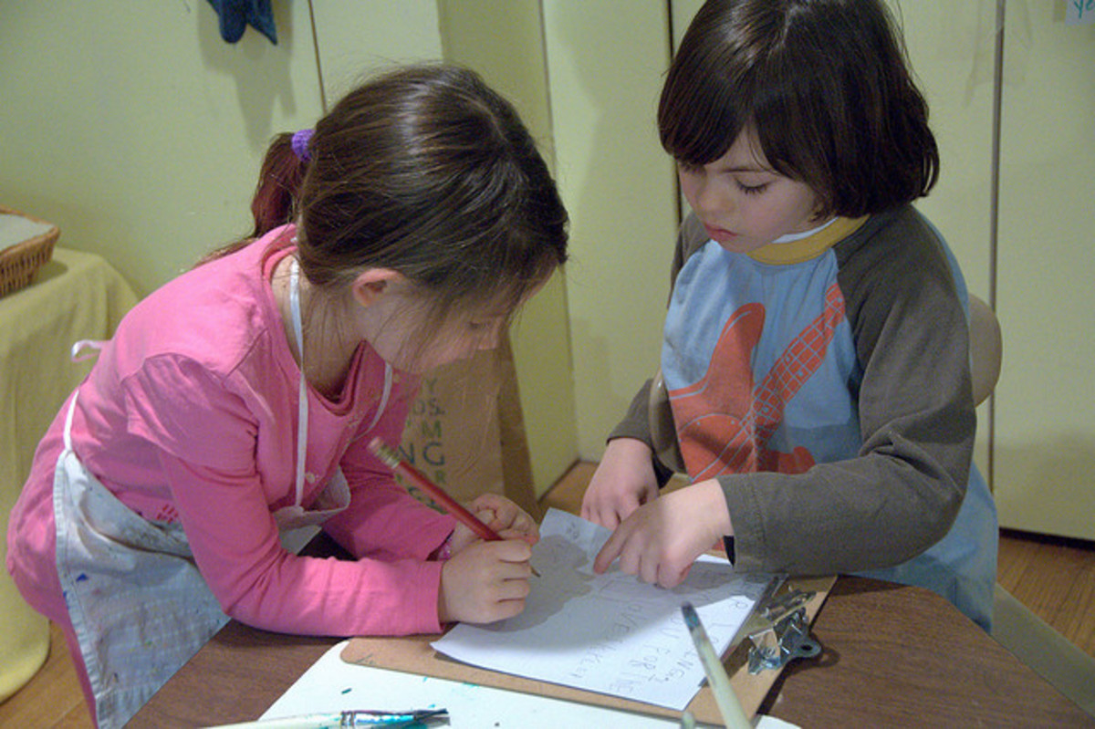 Keep children busy by having them write letters or draw pictures.