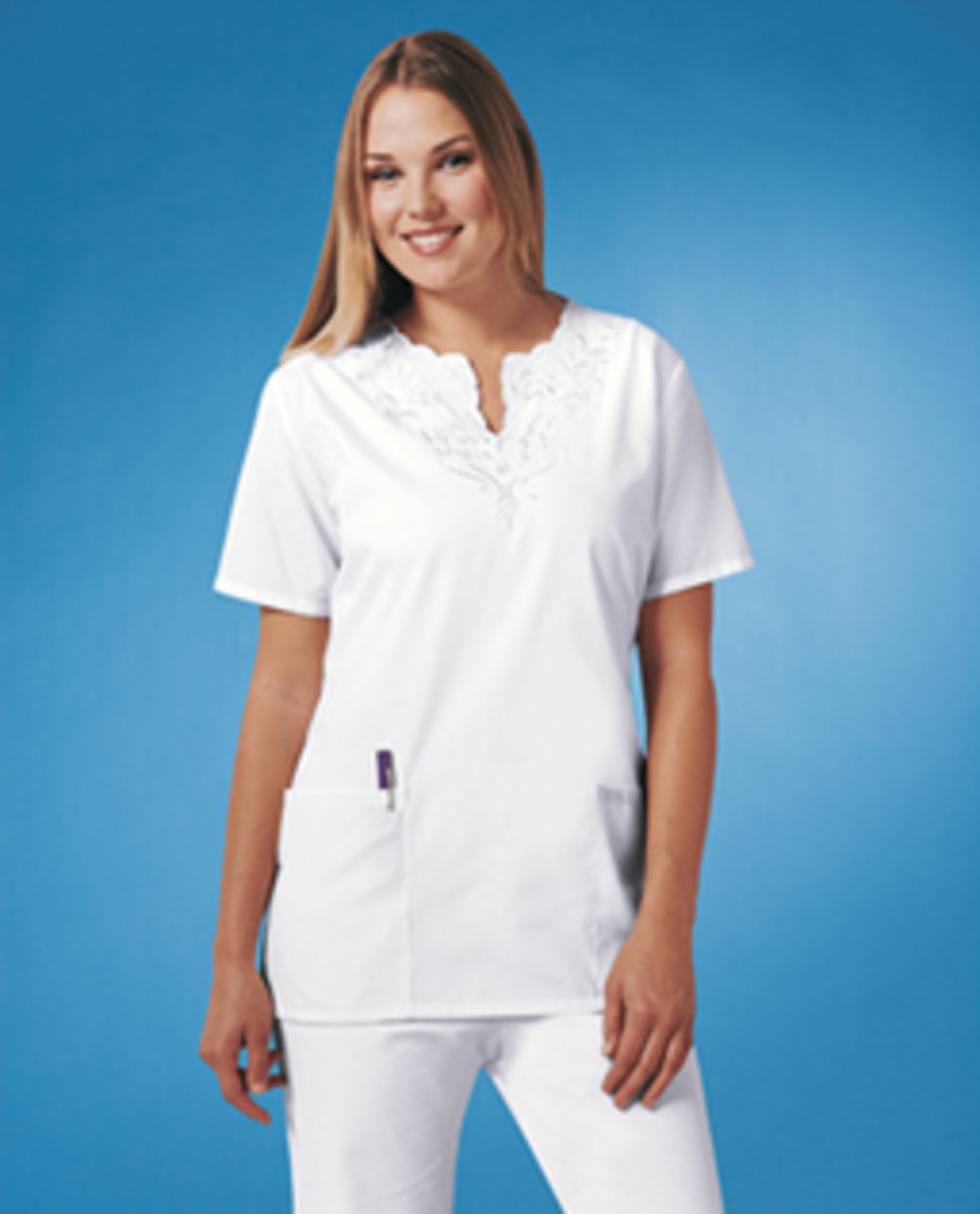 White scrubs with scalloping on neckline and with tone-on-tone embroidery