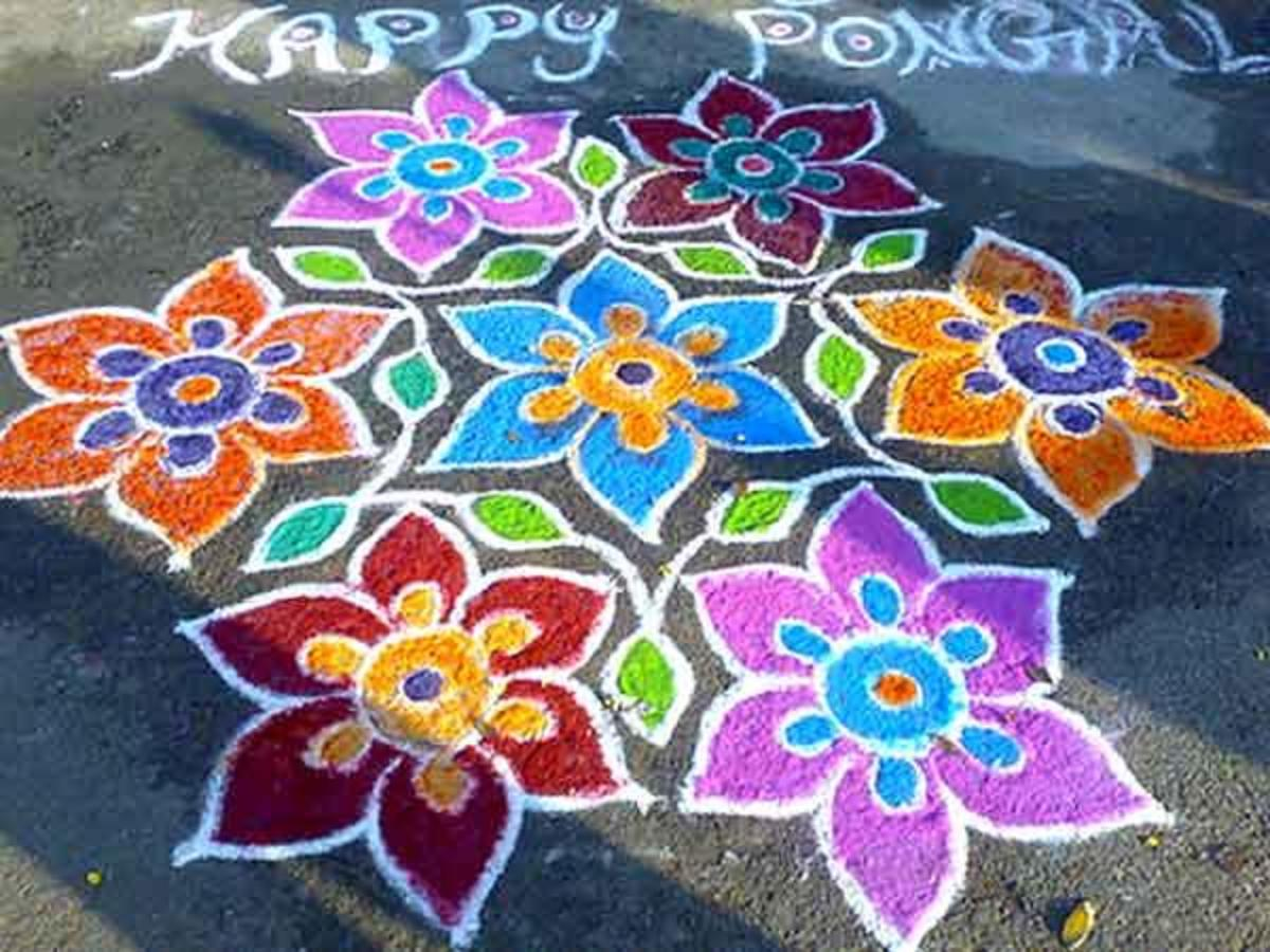 The design is filled with colored rice flour for the festival of Pongal