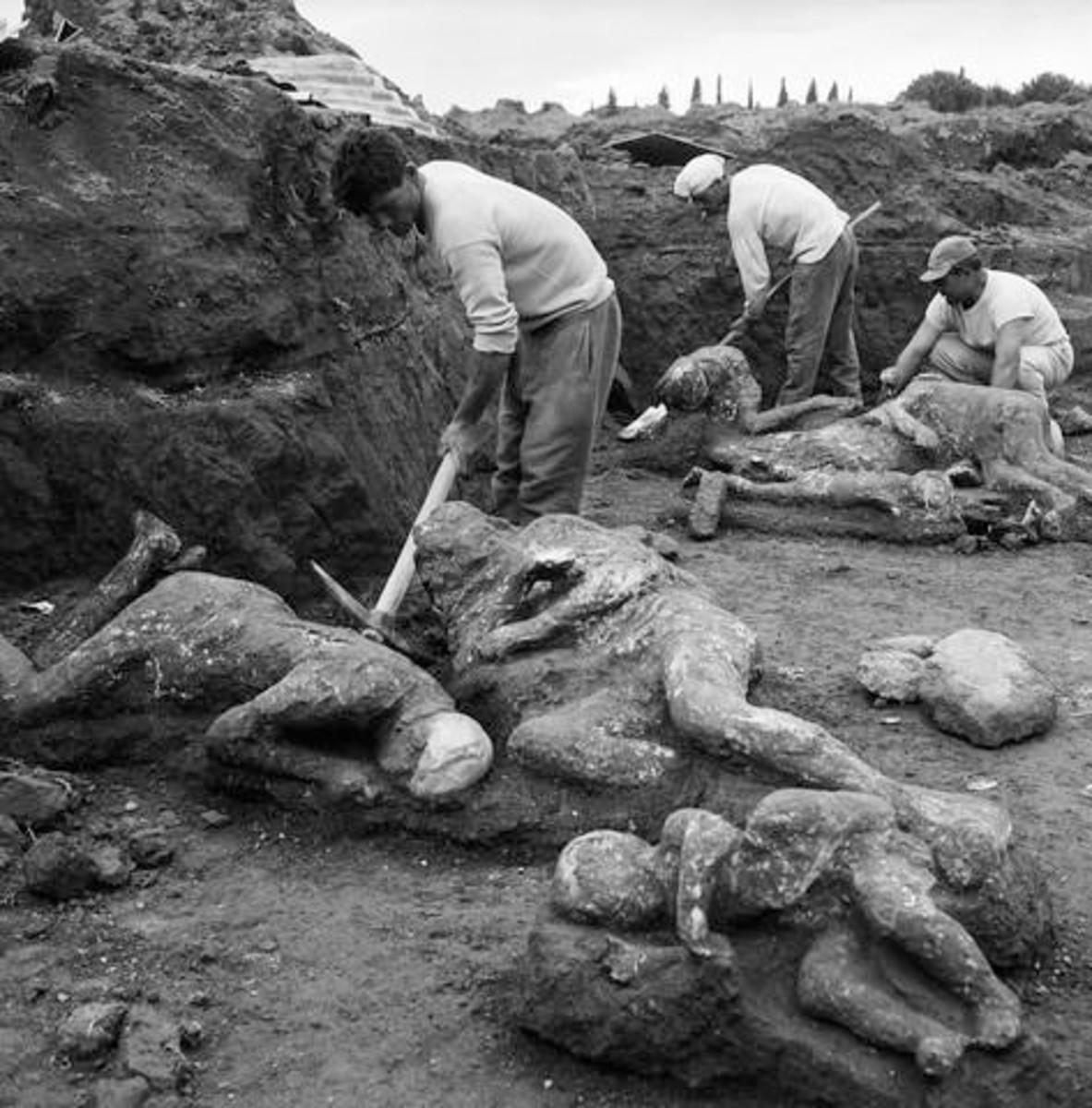 Excavation around plaster casts at Pompeii