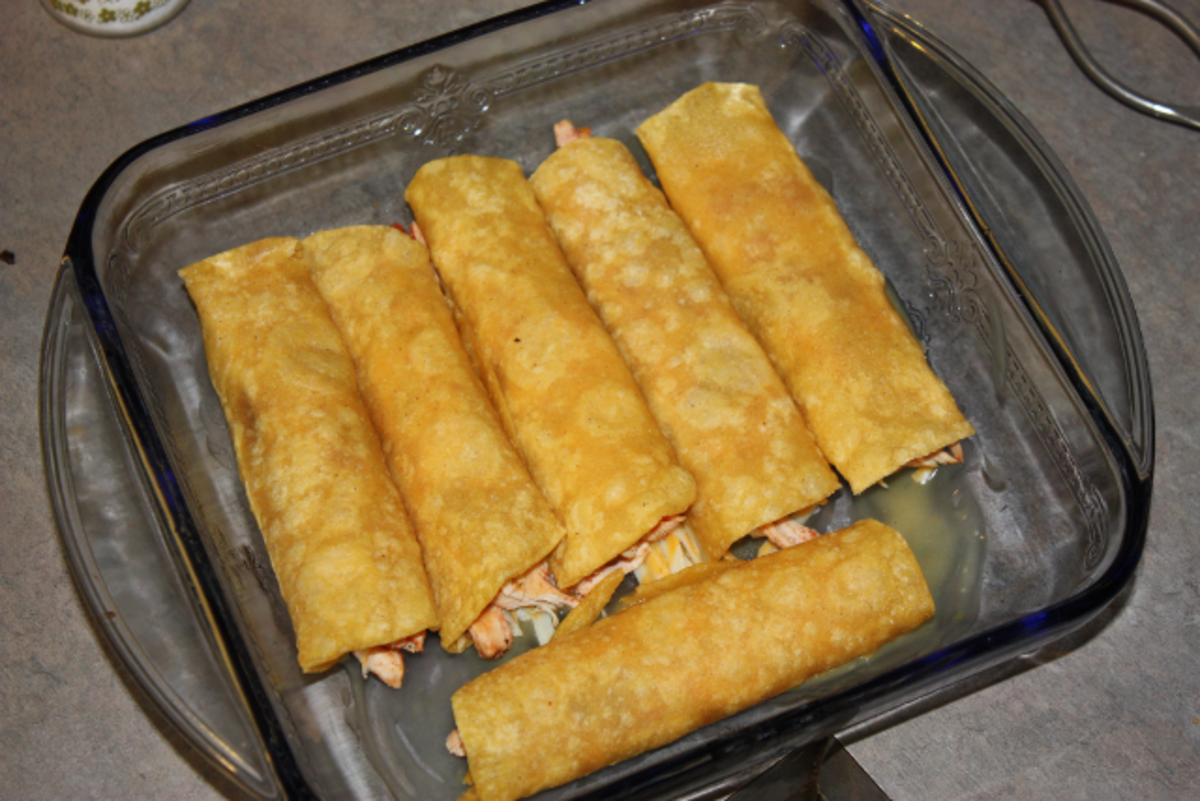 Enchiladas place in baking dish.