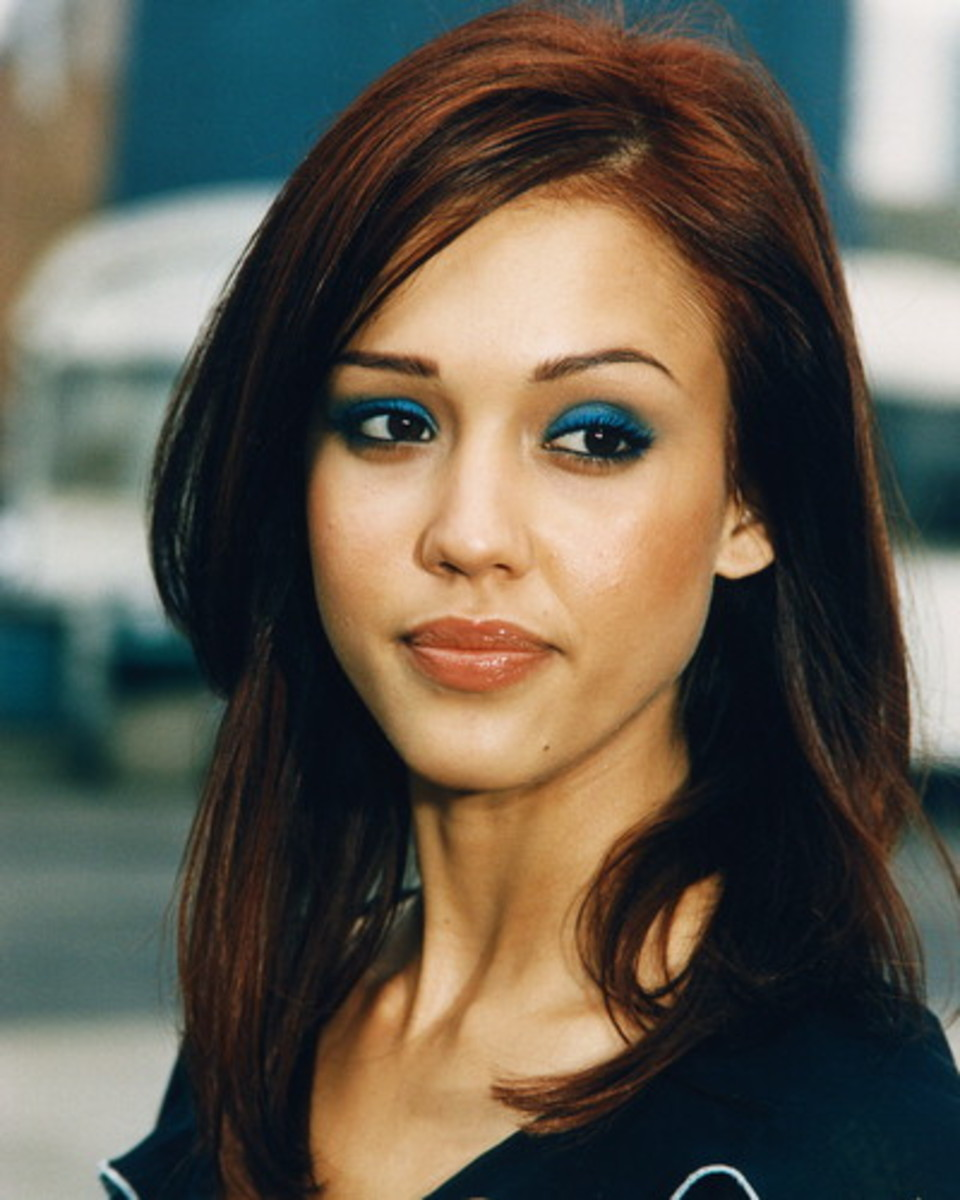 Jessica Alba. Shes a bank teller, but not a very good one. Hired strictly for her good looks.