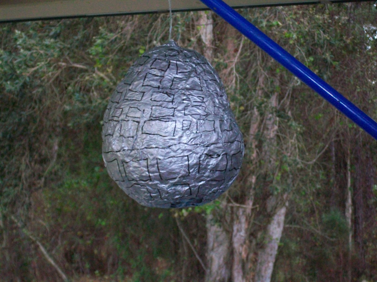Here's a Death Star pinata made from paper mach e, filled with candy and ready to be broken by lightsabers.