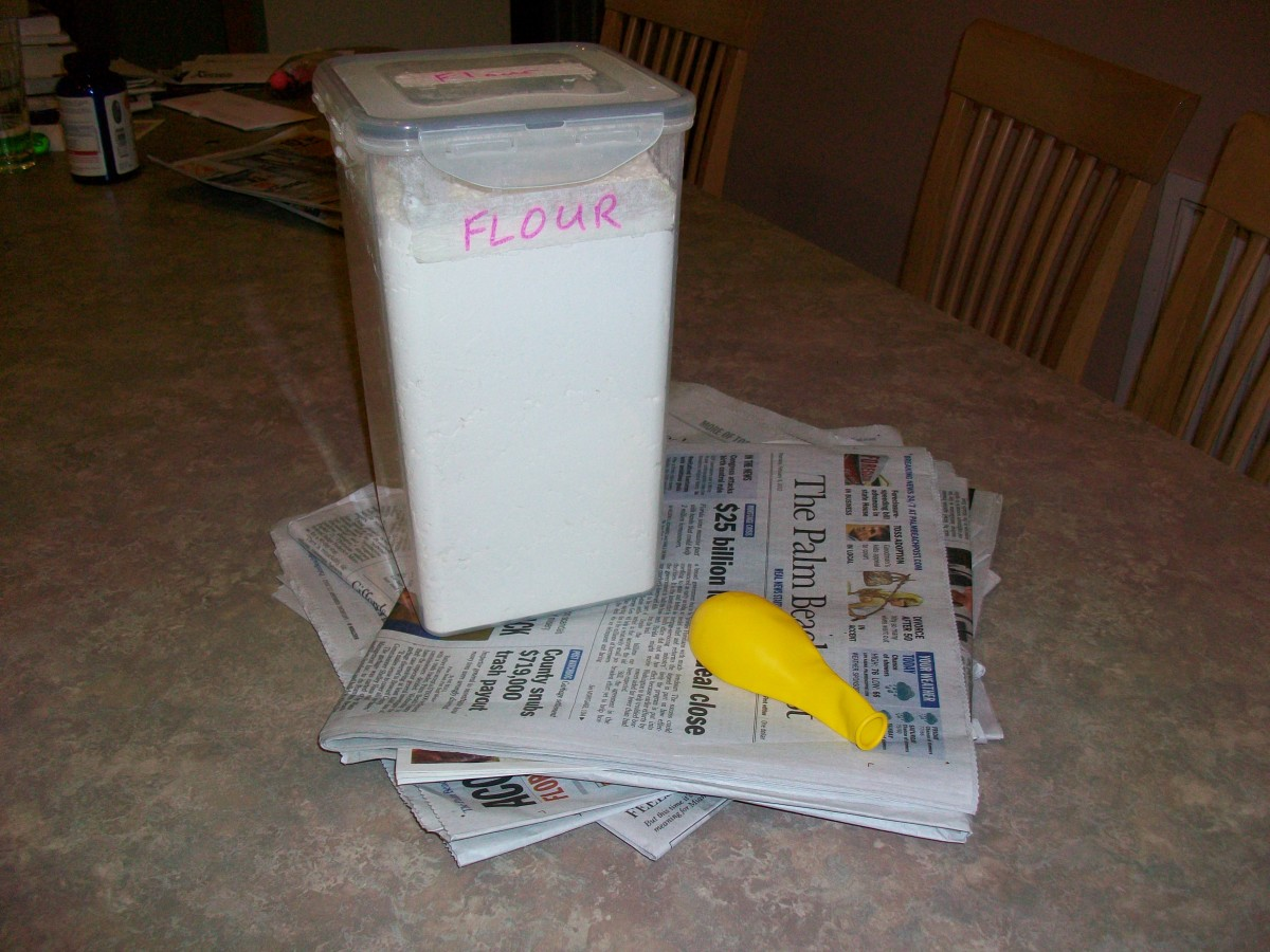 The basic tools of papier-mâché: flour, newspaper, and a balloon.