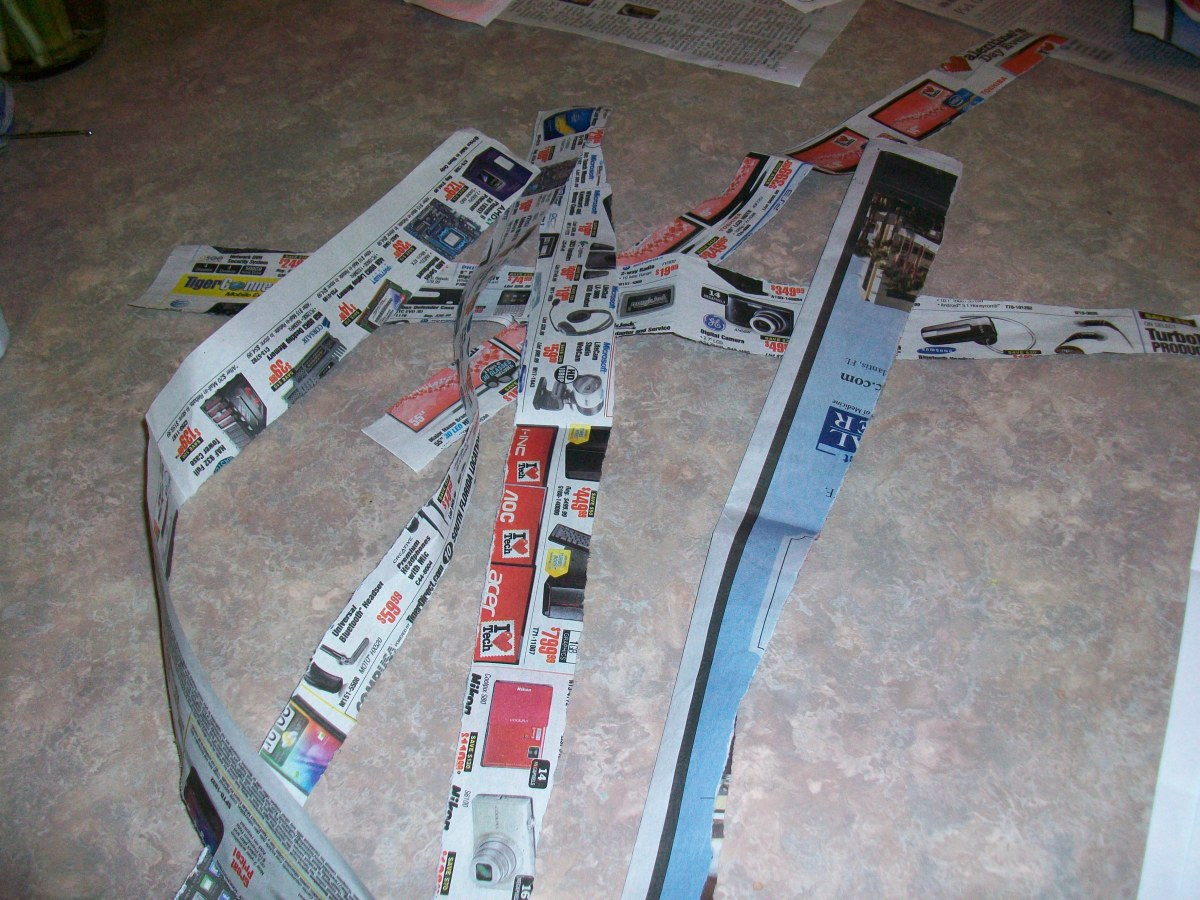 Rip strips of newspaper.