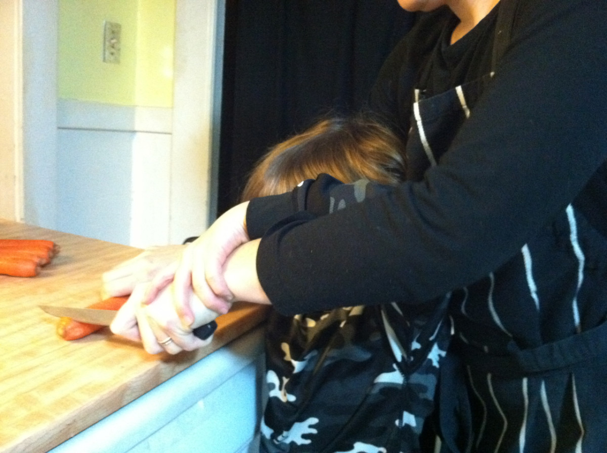 "Younger children can ""help"" you cut vegetables, by placing their hand on top of yours."