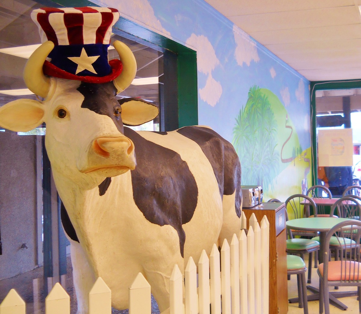 The Frozen Moo has a life size statue of a cow that moos when she feels like welcoming patrons to this colorful ice cream parlor in Coligny Plaza.