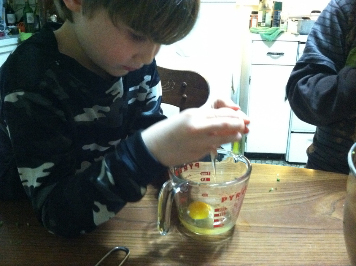 Kids should crack eggs into a separate container, so it is easier to remove any shells that sneak in.
