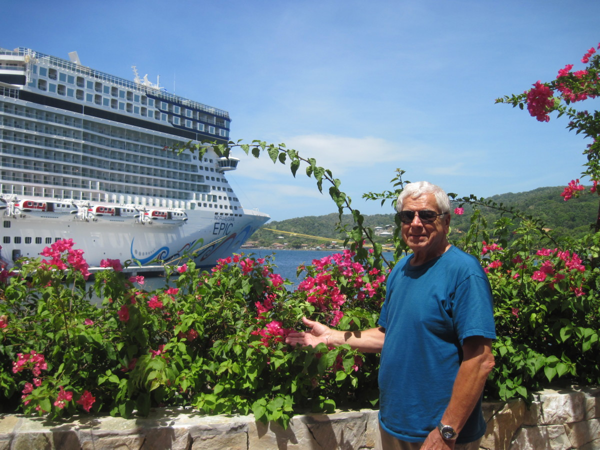 Chuck Hellier  on the island of Roatan with the cruise ship Norwegian Epic in the background.