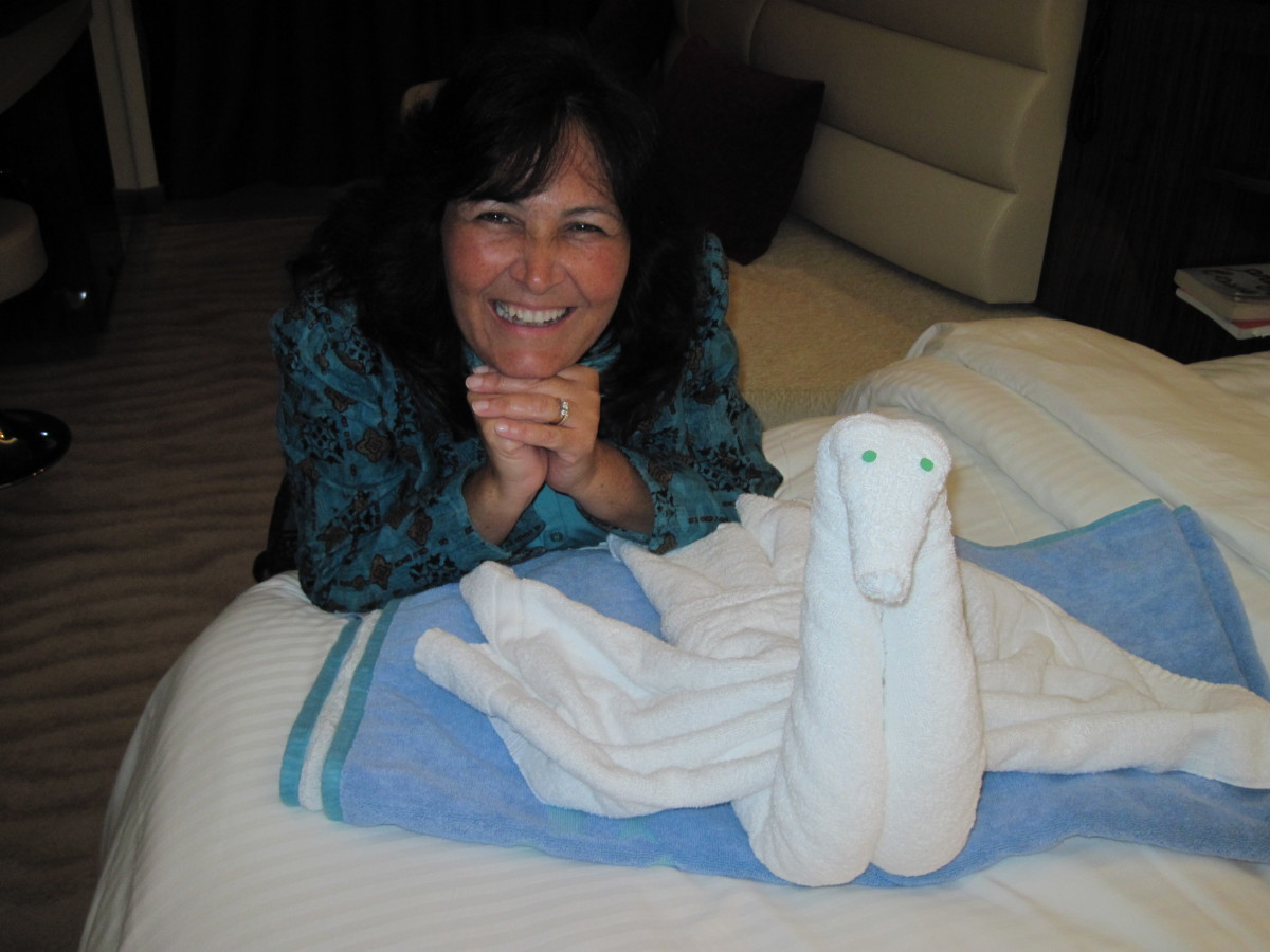 Towel animals made by the wonderful cruise ship staff members on many ships greet passengers on their beds when they return from dinner.
