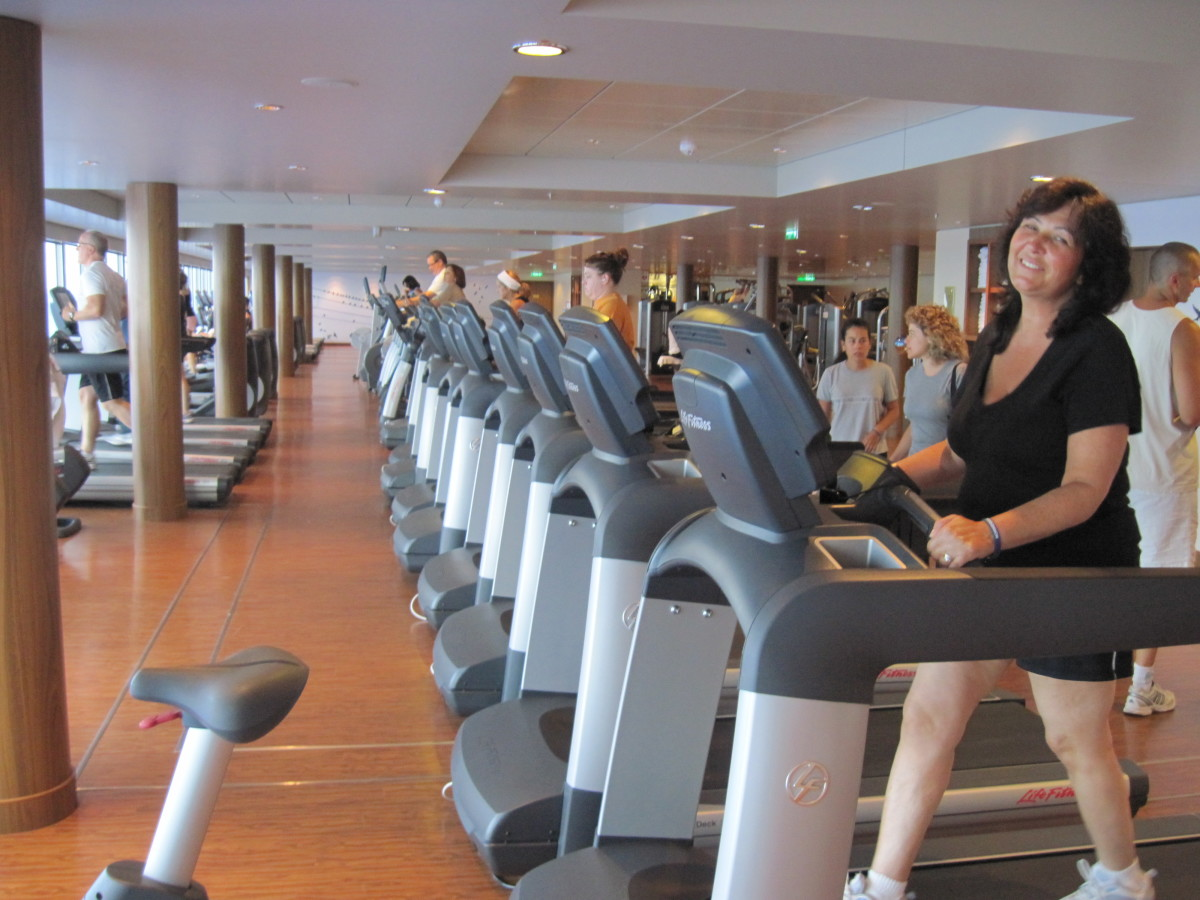 Working out in the Norwegian Epic's workout center to burn off some of the calories from all the good cruise food!