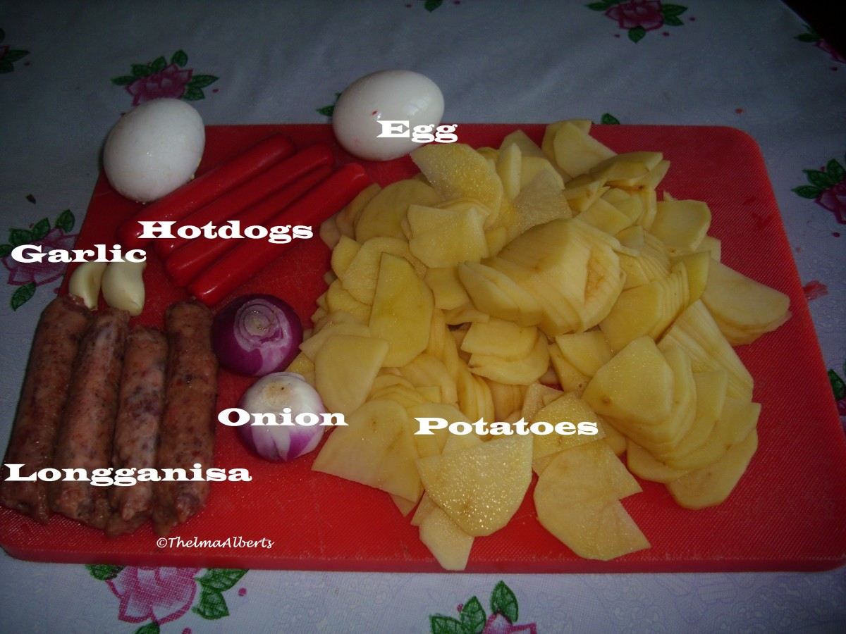 Some of the ingredients. Eggs, garlic, hotdogs, longganisa and potatoes.