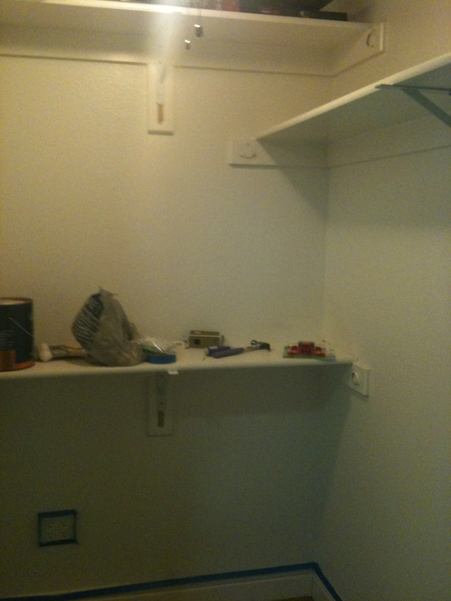 Clothes rods were removed but shelving remained.