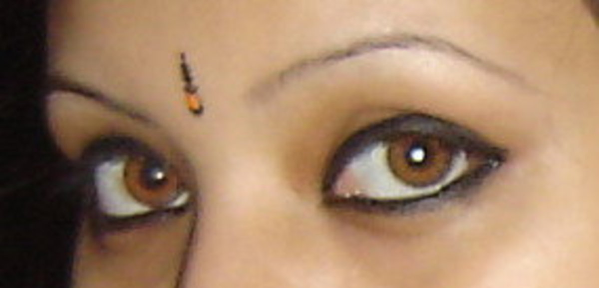 It is a photograph of me wearing my pair of honey contacts by freshlook
