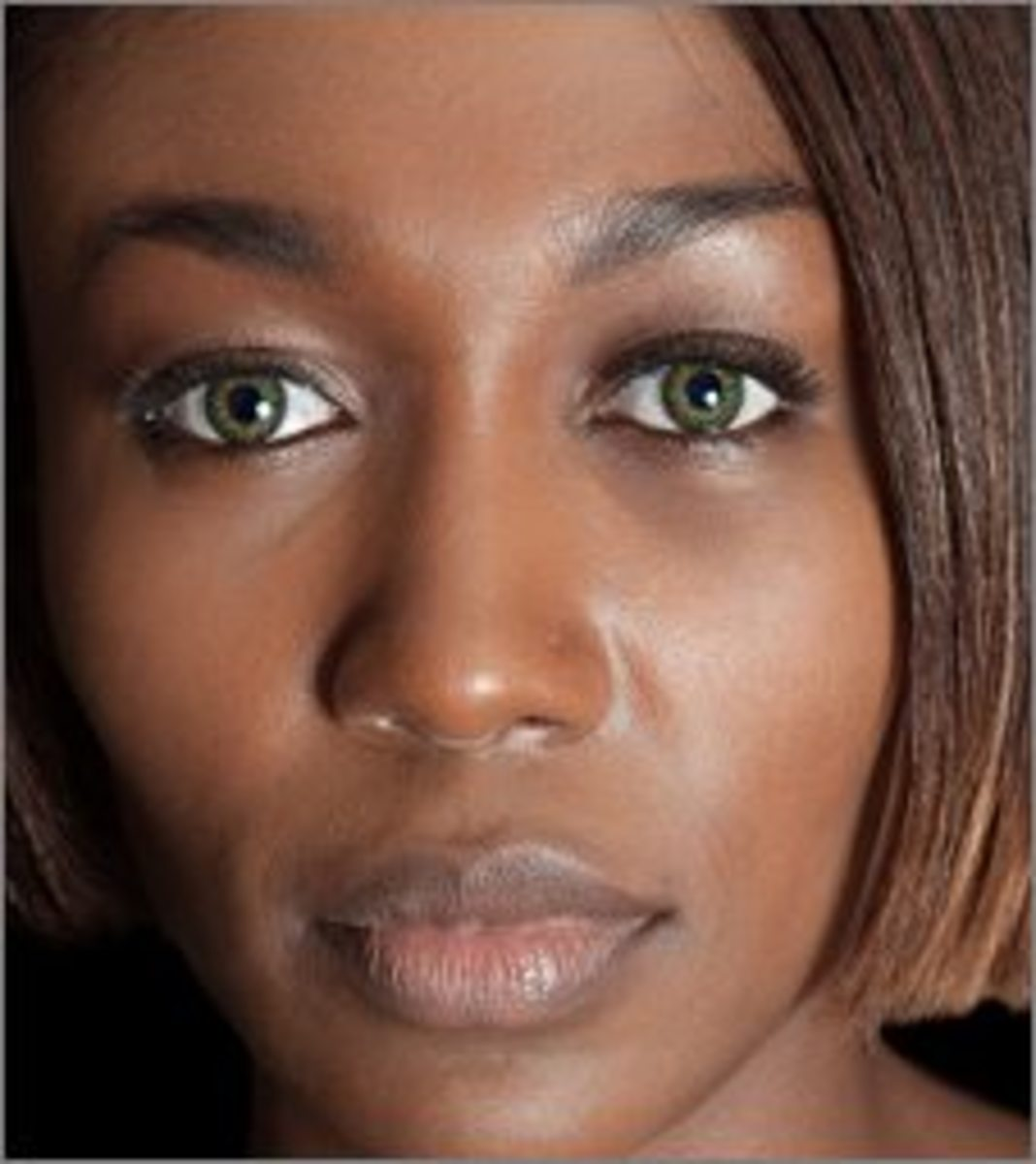 Green contacts look great on dark milk chocolate skin