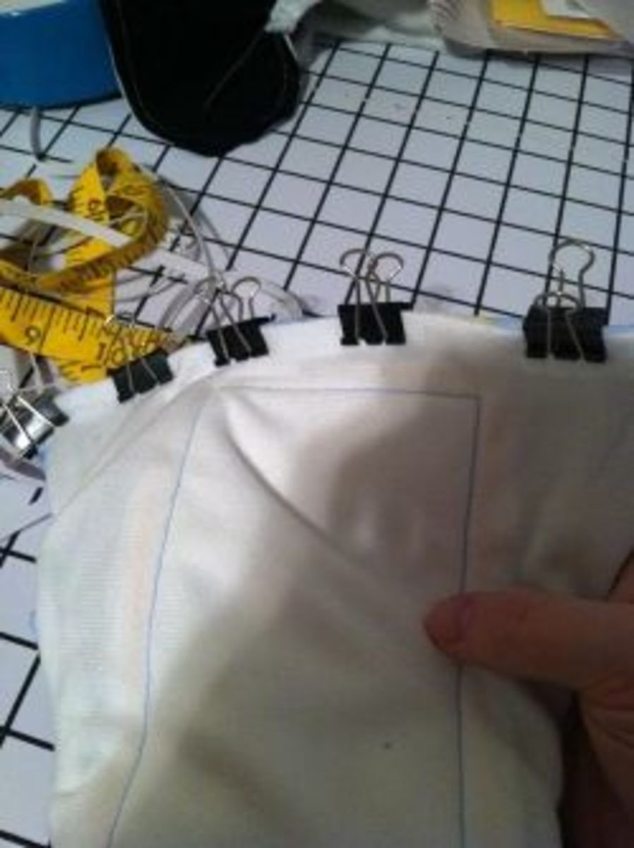 Use binder clips to hold the turned-in fabrics together.