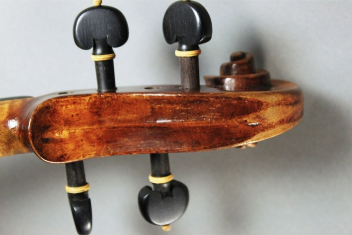 Neatly fluted back of the pegbox with little gauging on this Carlo Antonio Testore violin.