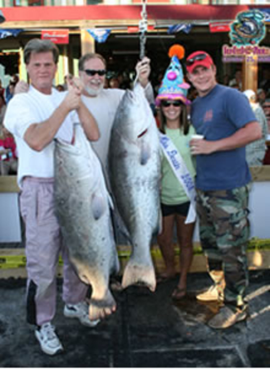 "Party Time! Captain Jim Westbrook, ""New Florida Girl"" set Andrew Bar of Carrollton, Georgia and Gary Scharmen of Fort Walton Beach, Florida onto a fine catch of Grouper! Bar's fish weighed in at 62.4 lbs. and took first place in the Charter Boat Divi"