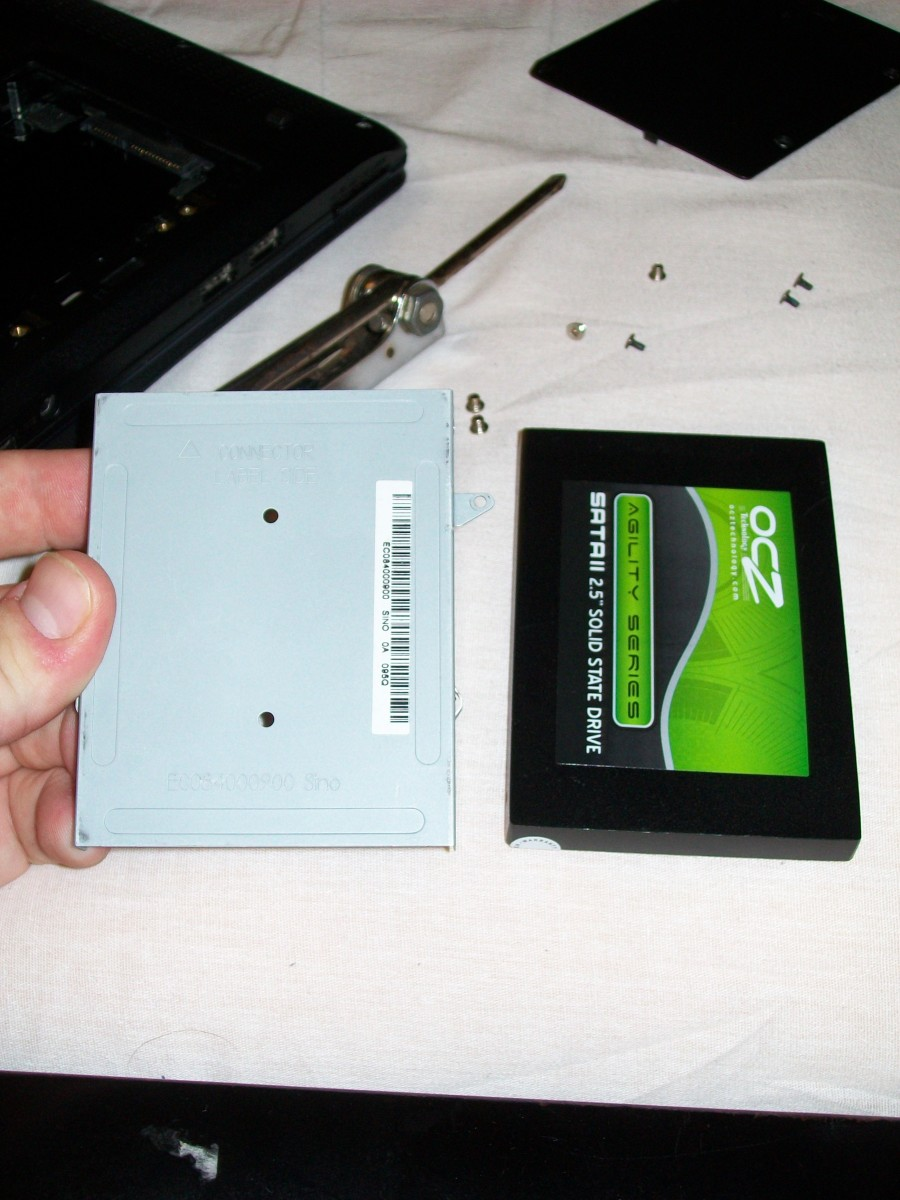 Attach the caddy to the new hard drive or SSD