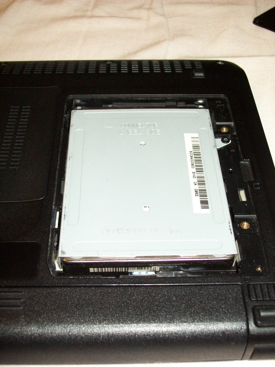 The hard drive caddy is secured by a single screw