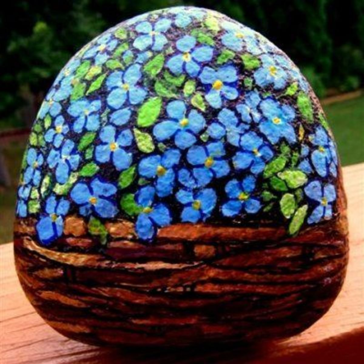 This is my forget me not flower basket rock that I painted and sold years ago.  Forget me nots painted on a rock make a wonderful gift of flowers that live forever!