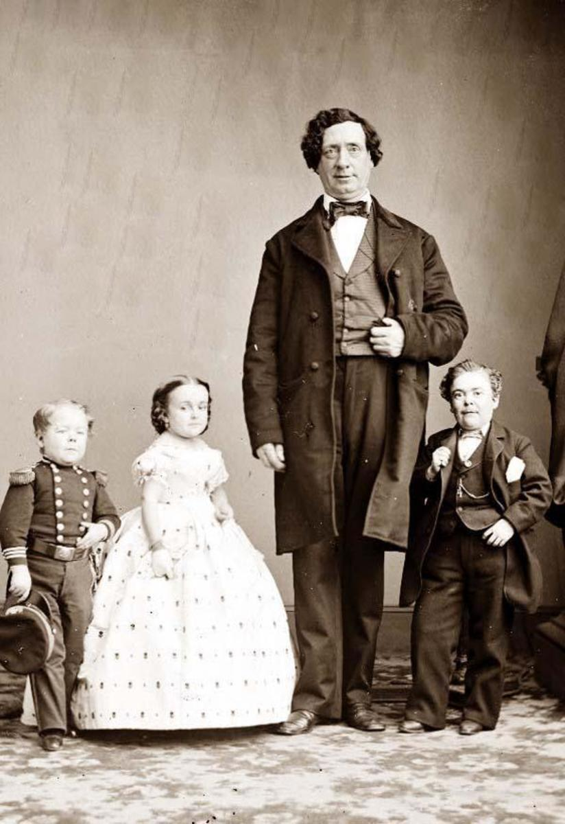 Gen. Tom Thumb (Charles Stratton) and Lavinia Warren on their  wedding day with Commodore Nutt and the Giant.