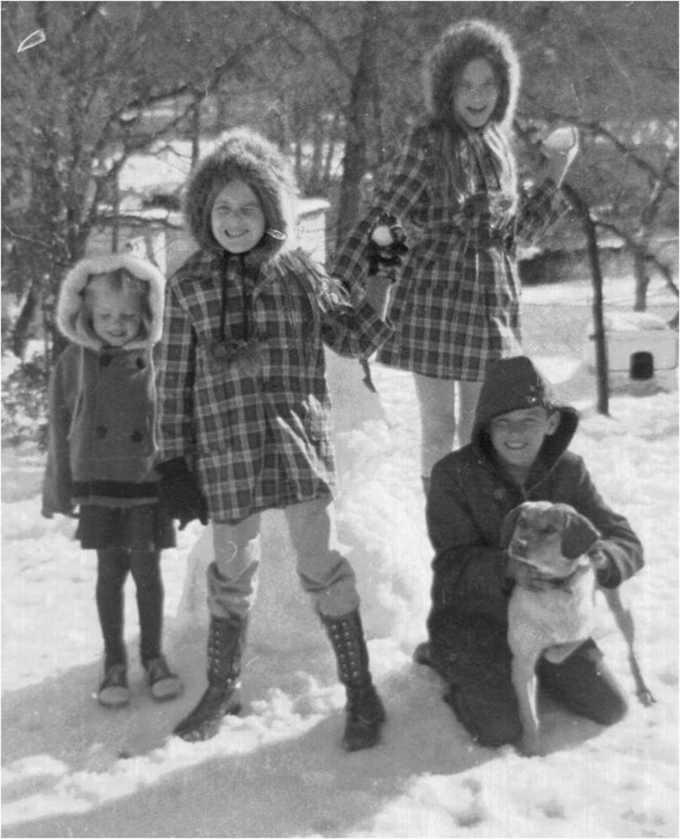 Freak snow day in the South.  My siblings and I and Brownie.  I am the oldest one behind my brother.  Look at those outfits LOL.