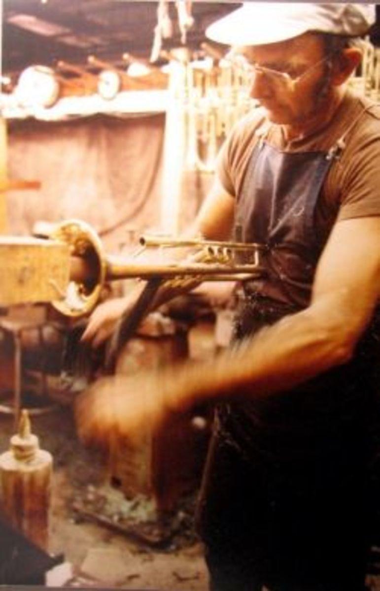 Hand polising a Selmer trumpet