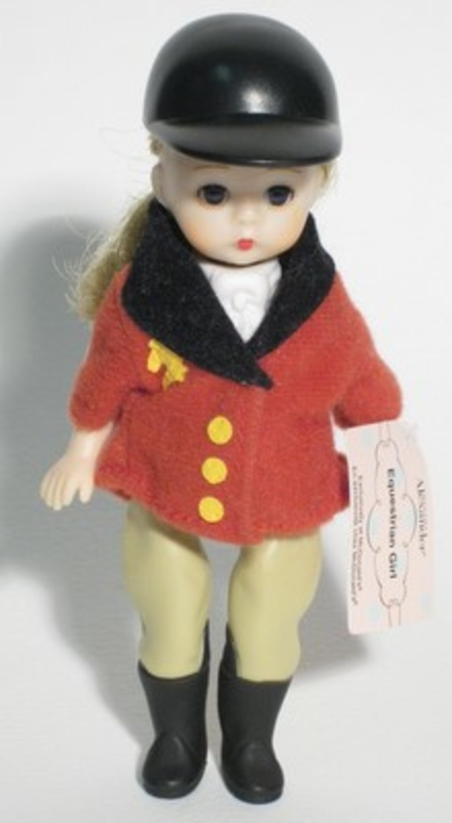 Madame Alexander Equestrian doll in classic red jacket with buff colored breeches