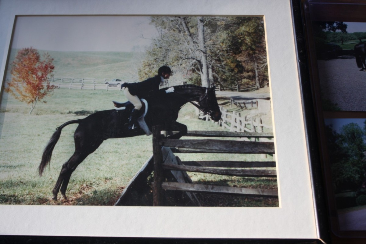 photo of Jackie Kennedy horse back riding and jumping in her riding outfit complete with hat