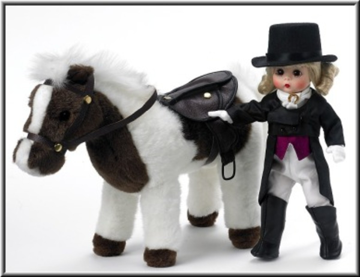 This Madame Alexander Girl is very elegant in her Equestrian long tail black coat, white pants, red vest, white scarf with gold horse shoe charm, black high top boots, and black Top Hat. She comes with a White and Brown plush Horse.