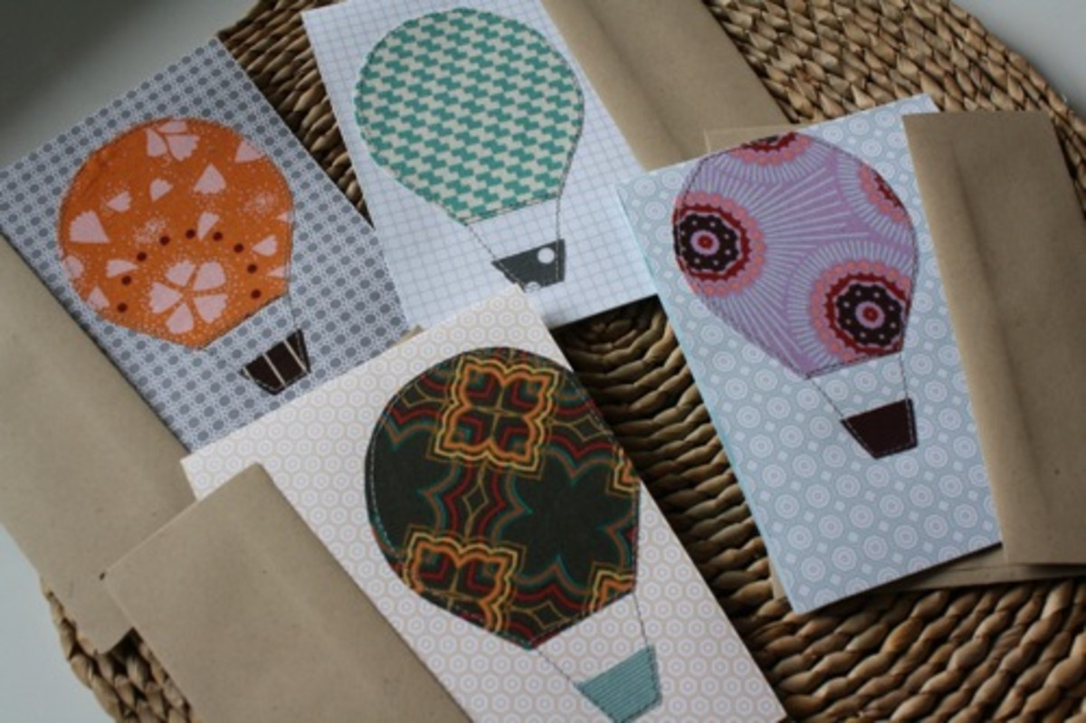 http://thecraftingchicks.com/2011/05/fabric-applique-greeting-cards-angela-flicker.html - link no longer active