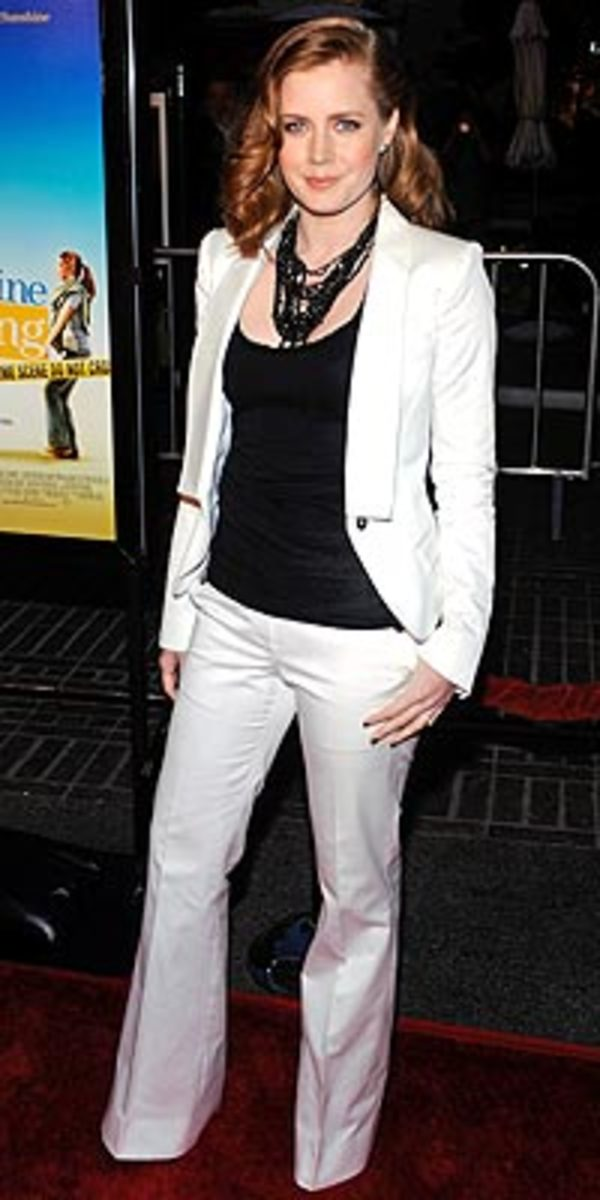 While Amy Adams has the right to wear a nice charming set of suit and slacks when the mood takes her....