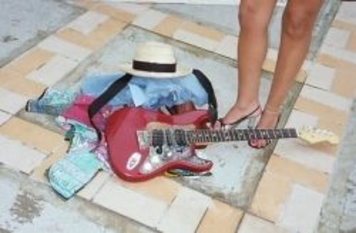 Guitar, clothes and legs | Initial logo for Jamaica Blues Jam | Taken at Hedonism Resort Jam in Jamaica