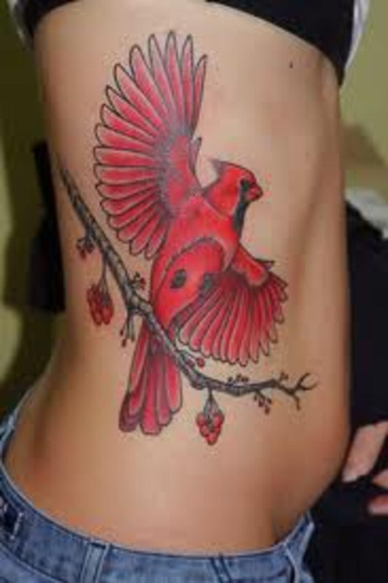 Cardinal flying tattoo