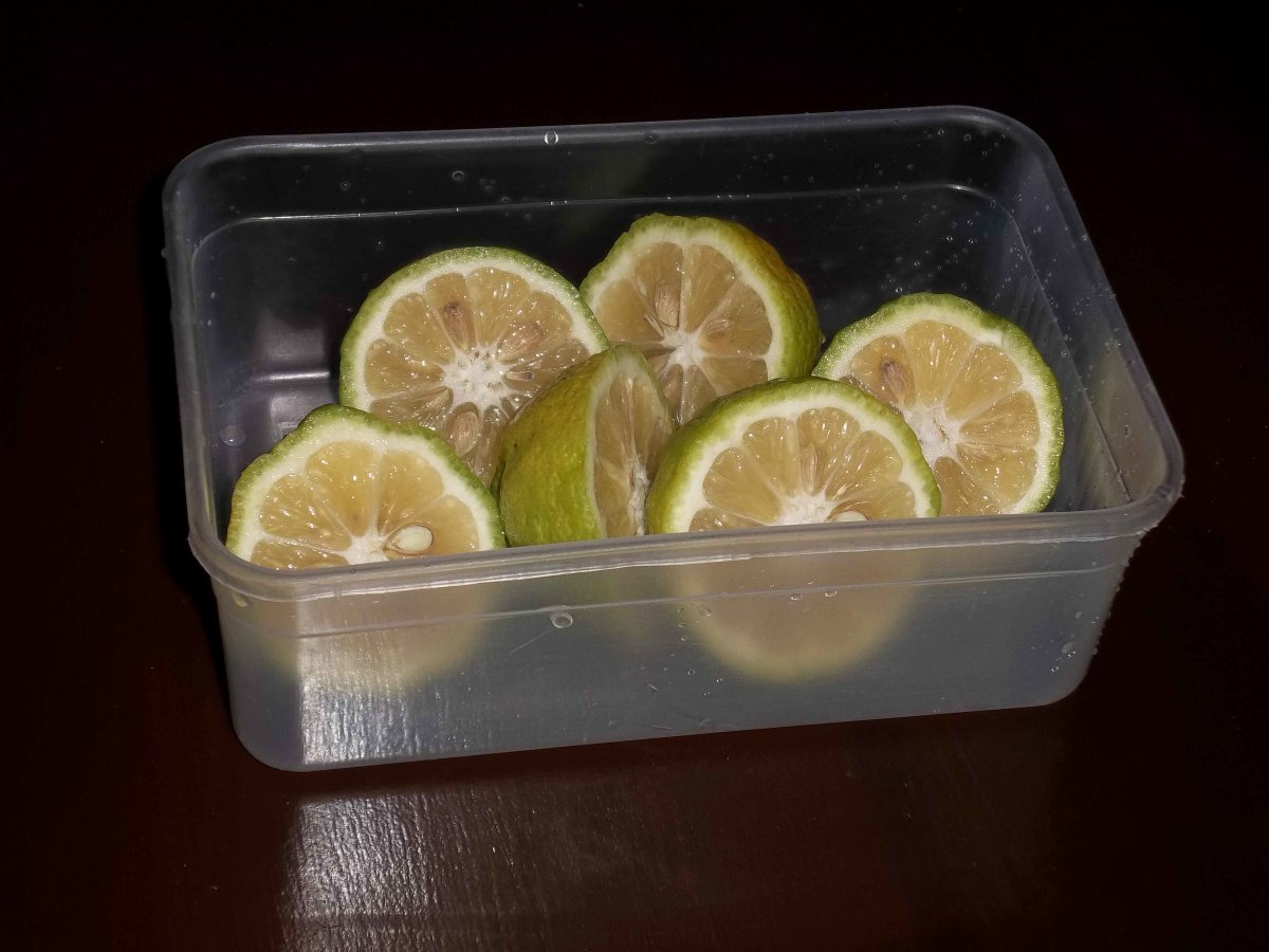 Slice the lemons in half and get the juice out. Use any method you know as long as you squeeze the juice out