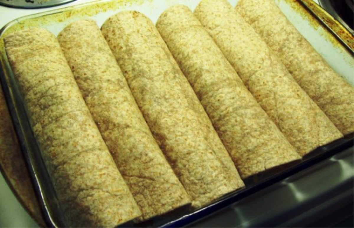 Spoon the veggie crumbles and beans onto tortillas and roll up in 9 x 12 pan.