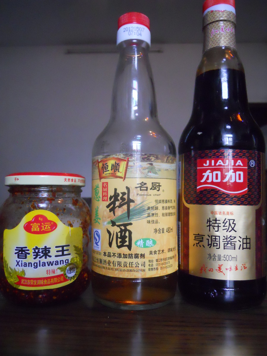 Left to right; la jiao, Chinese cooking wine and soy sauce.