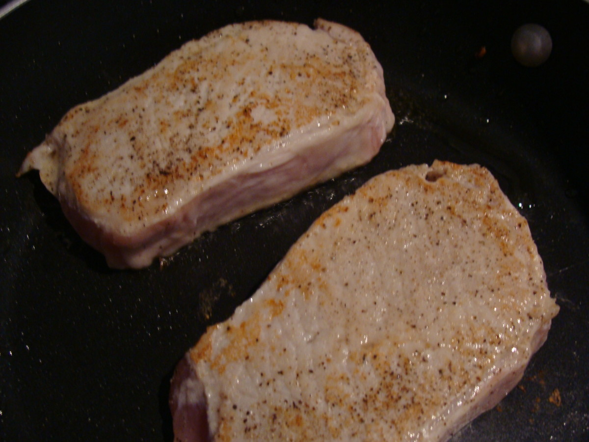 Brown the pork chops on each side.