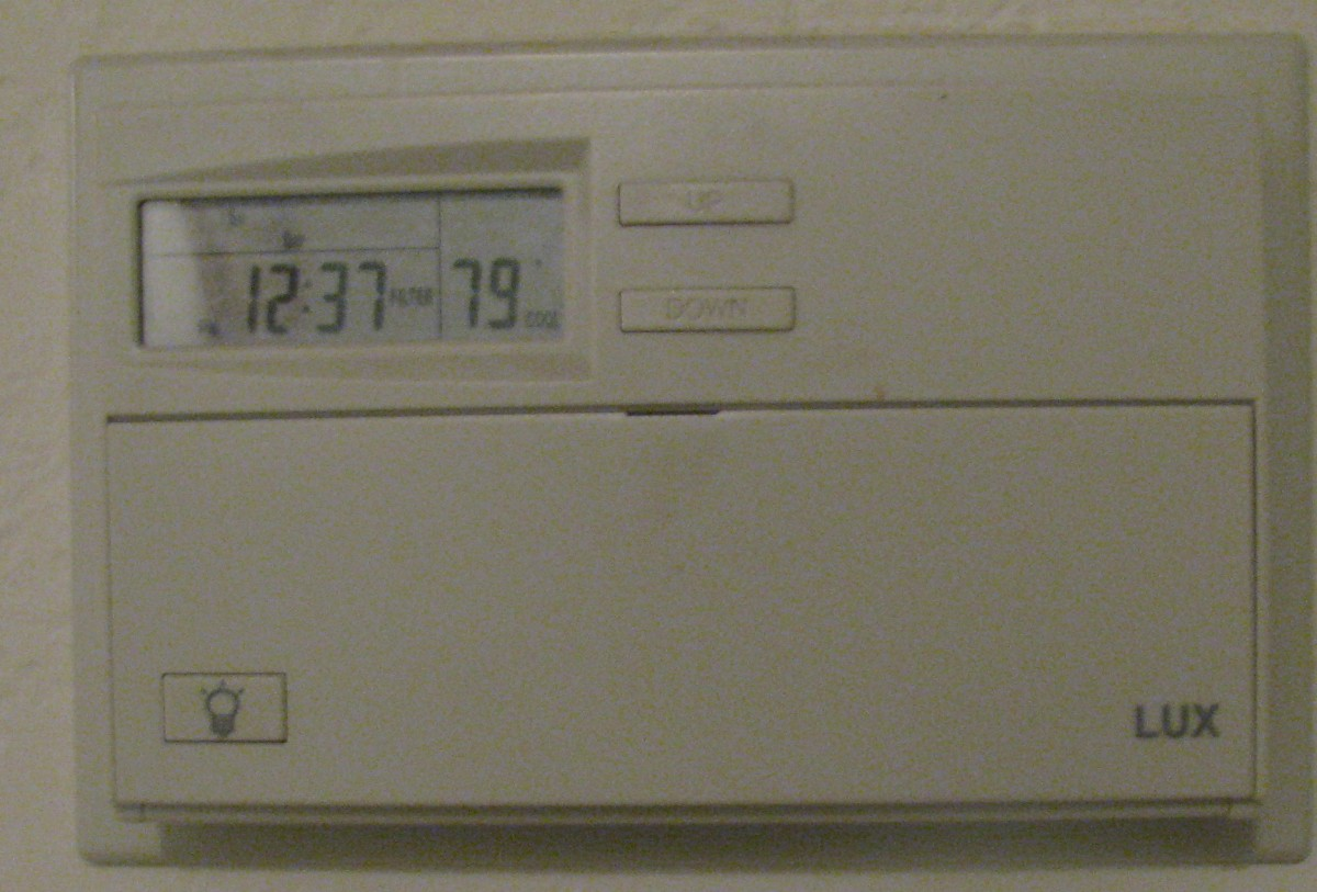 Smart grids would link programmable thermostats like this in private homes to centralized control centers to regulate power usage.