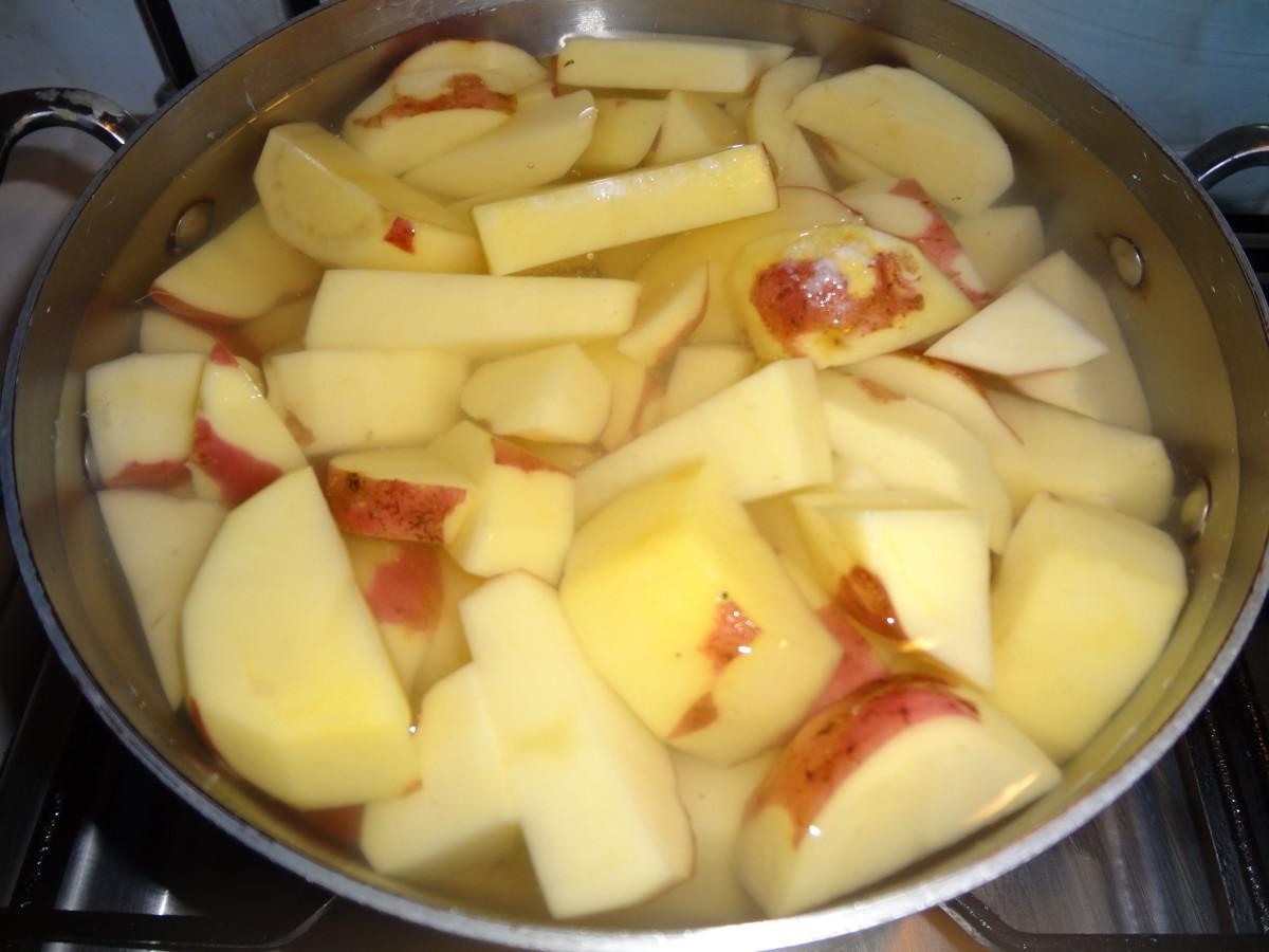 I peel half of the potatoes