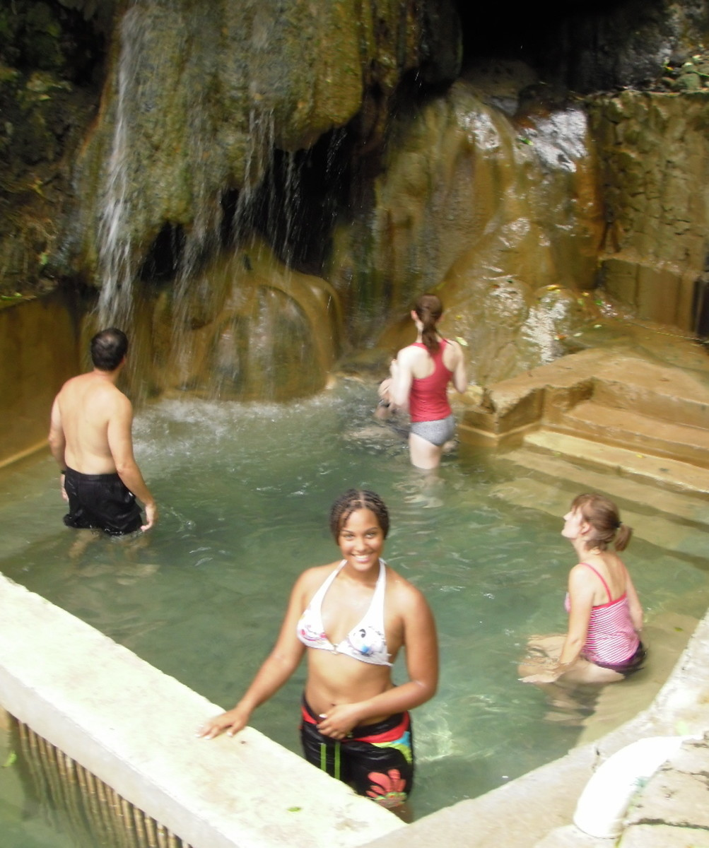 The volcanic hot springs mix with a mountain waterfall in the constructed basin near Malgretoute, Soufriere.