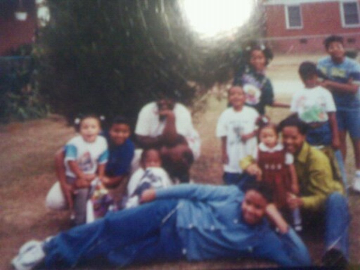 Me and Jacey in the far right in Red and Green with some of our cousins.