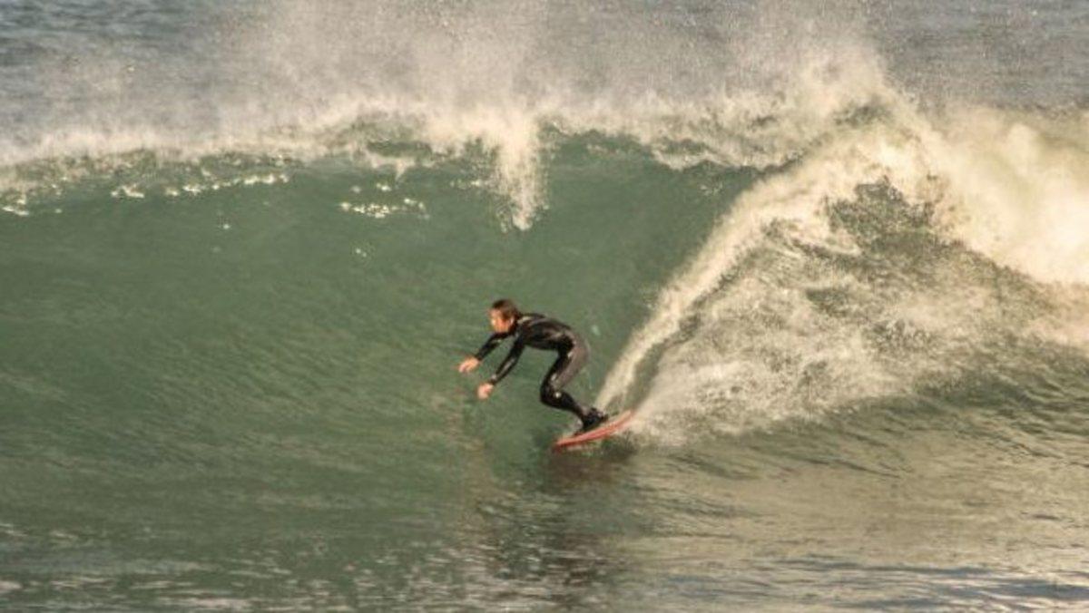 Ben Linden surfing